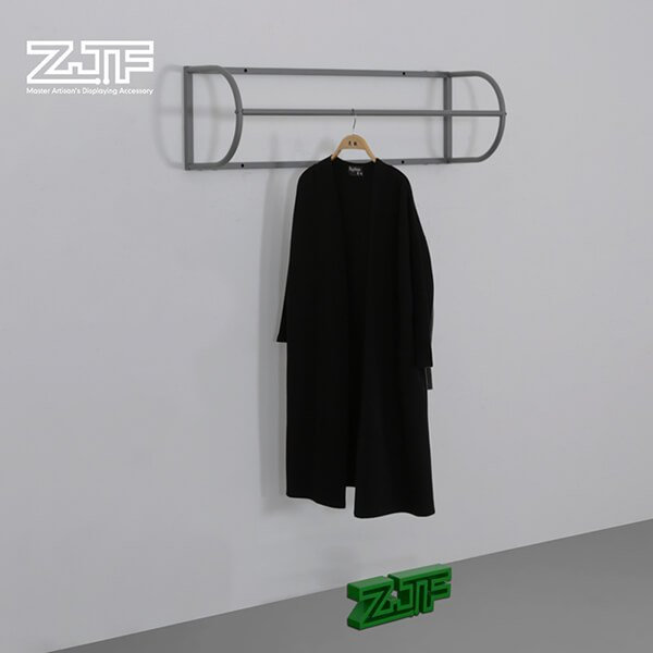 Curved wall mounted metallic clothes rack display