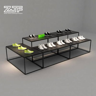 Black high and low iron shoes display table